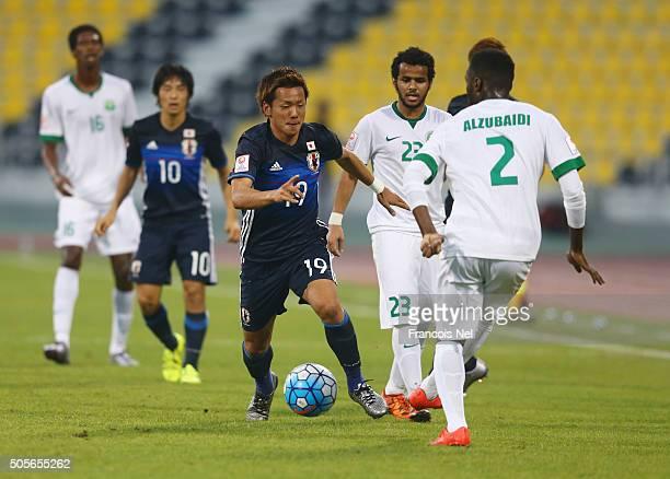 Ali Alzubaidi of Saudi Arabia is closed down by Yosuke Ideguchi of Japan during the AFC U23 Championship Group B match between Saudi Arabia and...