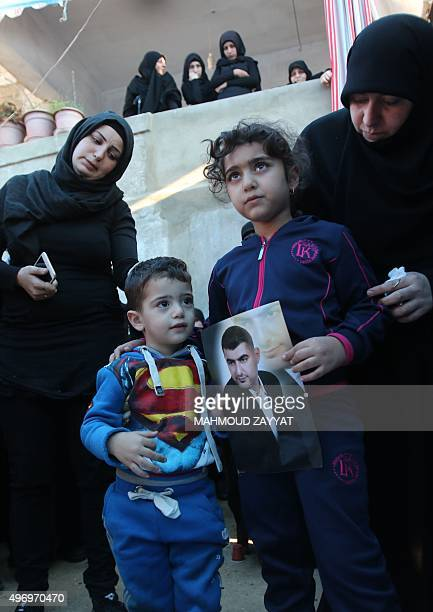 Ali and Malak , the children of Adel Termos, who was killed in a twin bombing attack that rocked a busy shopping street in the area of Burj...
