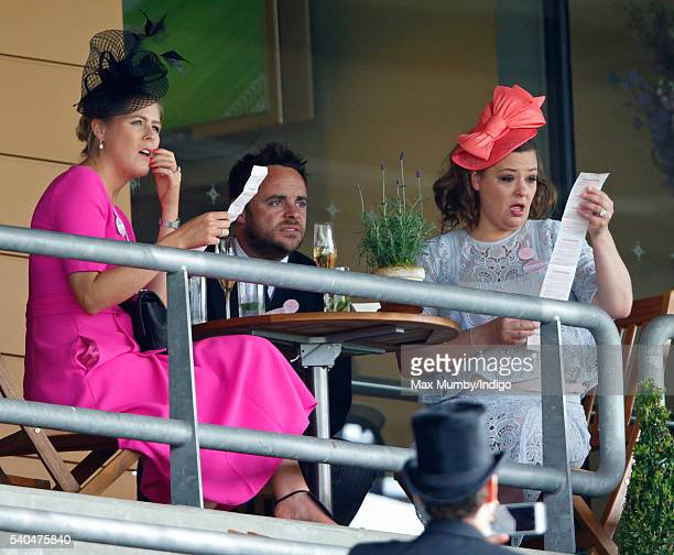 Ali Astall Anthony McPartlin and Lisa Armstrong watch the racing as they attend day 2 of Royal Ascot at Ascot Racecourse on June 15 2016 in Ascot...