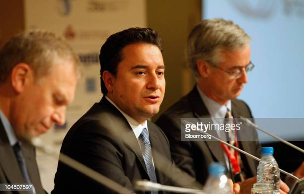 Ali Babacan Turkey's deputy prime minister center speaks while James Leape director general of the World Wildlife Fund right and Yves Leterme former...