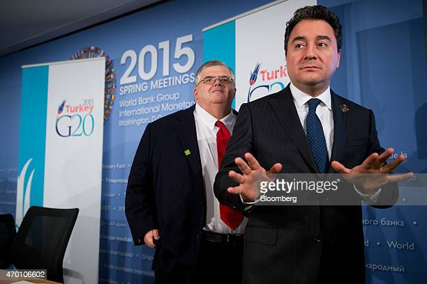Ali Babacan Turkey's deputy prime minister right speaks to members of the media after a news conference with Agustin Carstens governor of the Bank of...