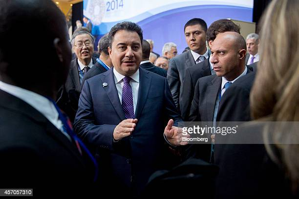 Ali Babacan Turkey's deputy prime minister walks away after the International Monetary Fund Committee governors family photograph during the...