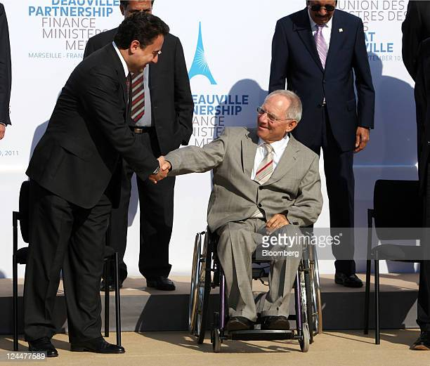 Ali Babacan Turkey's finance minister left greets Wolfgang Schaeuble Germany's finance minister center during a meeting of the G7 finance ministers...