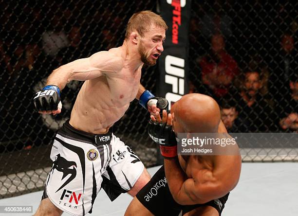 Ali Bagautinov fires a punch at Demetrious Mighty Mouse Johnson in their UFC flyweight championship bout at Rogers Arena on June 14 2014 in Vancouver...