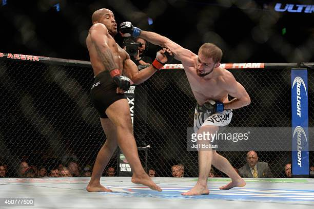 Ali Bagautinov misses a punch against UFC Flyweight Champion Demetrious 'Mighty Mouse' Johnson during their flyweight championship bout at the UFC...