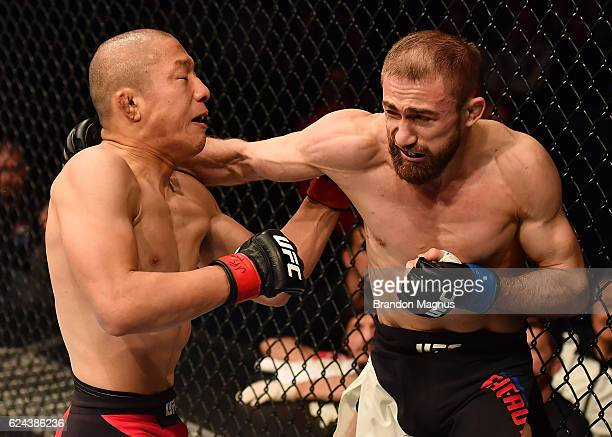 Ali Bagautinov of Russia punches Kyoji Horiguchi of Japan in their flyweight bout during the UFC Fight Night at the SSE Arena on November 19 2016 in...