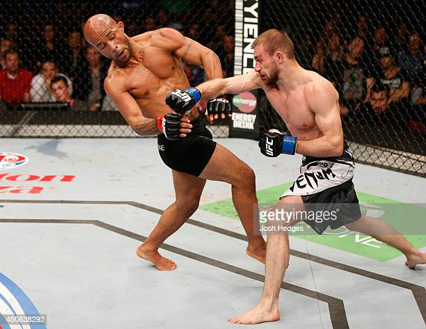 Ali Bagautinov punches Demetrious Mighty Mouse Johnson in their UFC flyweight championship bout at Rogers Arena on June 14 2014 in Vancouver Canada