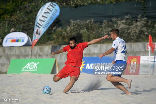 Ali Bagheri of Real Muenster against Max Kroetsching of Rostocker Robben during the German Beachsoccer League match between Rostocker Robben and Real...