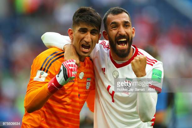 Ali Beiranvand and Roozebeh Cheshmi of IR Irann celebrate at the end of the 2018 FIFA World Cup Russia group B match between Morocco and Iran at...