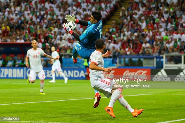 Ali Beiranvand of IR Iran claims the ball under pressure during the 2018 FIFA World Cup Russia group B match between Iran and Spain at Kazan Arena on...