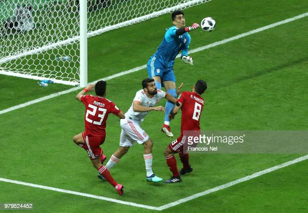 Ali Beiranvand of Iran clears the ball over Diego Costa of Spain during the 2018 FIFA World Cup Russia group B match between Iran and Spain at Kazan...