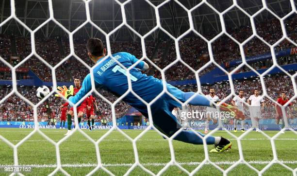 Ali Beiranvand of Iran saves a penalty from Cristiano Ronaldo of Portugal during the 2018 FIFA World Cup Russia group B match between Iran and...