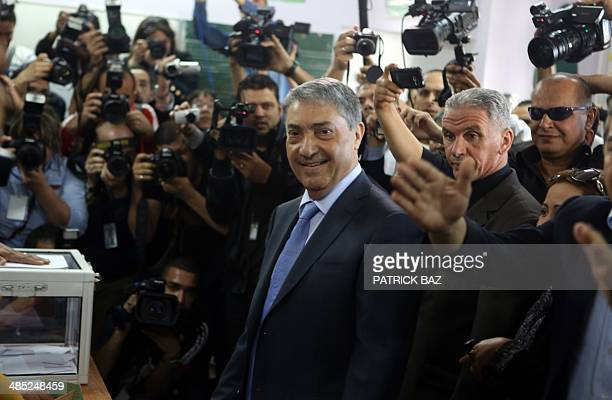 Ali Benflis Algerian opposition leader and main rival to Algerian President Abdelaziz Bouteflika arrives at a polling station to cast his vote in the...
