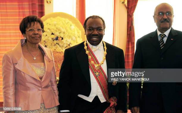 Ali Bongo Ondimba son of Gabon's late strongarm leader poses with Rose Francine Rogombe who served as acting president after Ondimba was sworn in as...