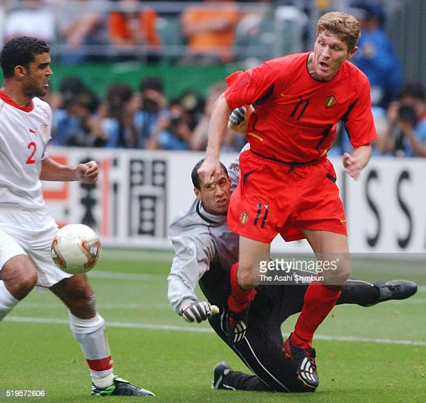 Ali Boumnijel of Tunisia and Gert Verheyen of Belgium compete for the ball during the FIFA World Cup Korea/Japan Group H match between Tunisia and...