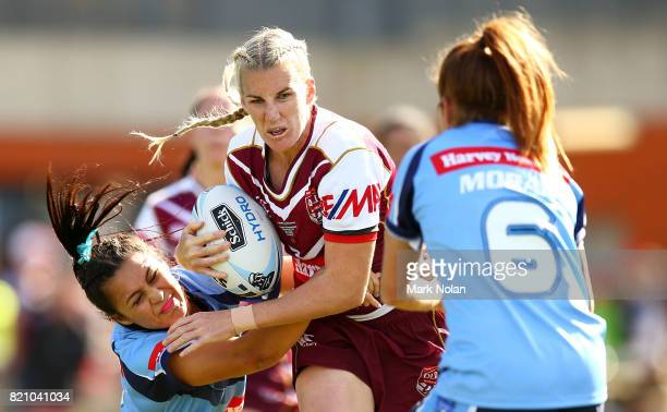 Ali Brigginshaw of Queensland is tackled during the Women's Interstate Challenge match between New South Wales and Queensland at WIN Stadium on July...
