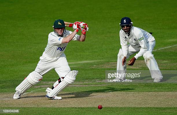 Ali Brown of Nottinghamsire hits the ball to the boundary during the LV County Championship match between Nottinghamshire and Warwickshire at Trent...