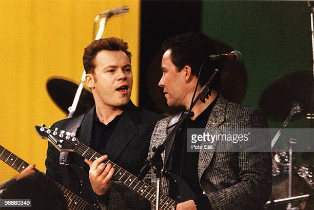 Ali Campbell and Robin Campbell of UB40 perform on stage at the Nelson Mandela 70th Birthday Tribute concert in Wembley Stadium on June 11th 1988 in...