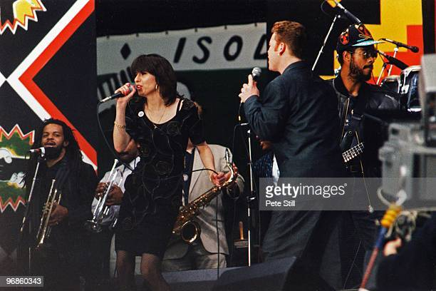 Ali Campbell of UB40 is joined on stage by Chrissie Hynde of The Pretenders to perform at the Nelson Mandela 70th Birthday Tribute concert in Wembley...