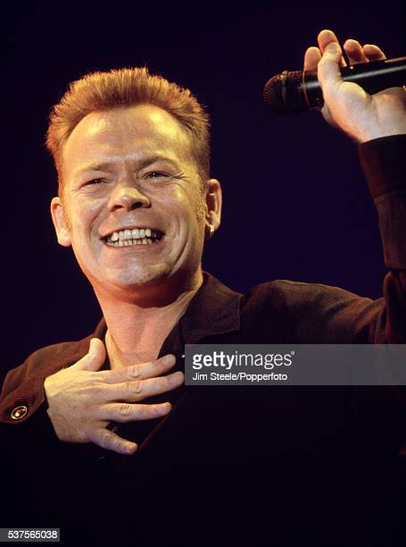 Ali Campbell of UB40 performing on stage at Wembley Arena in London circa January 1994