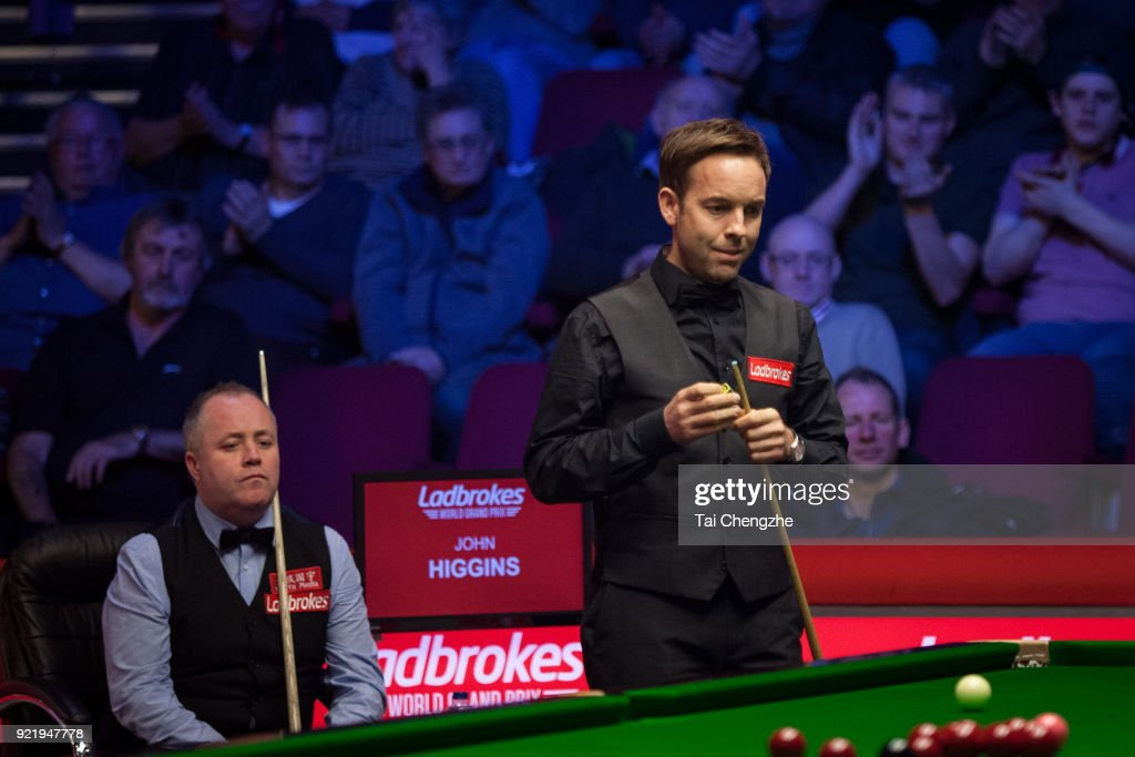 Ali Carter of England chalks the cue during his first round match against John Higgins of Scotland on day two of 2018 Ladbrokes World Grand Prix at Guild Hall on February 20, 2018 in Preston, England.