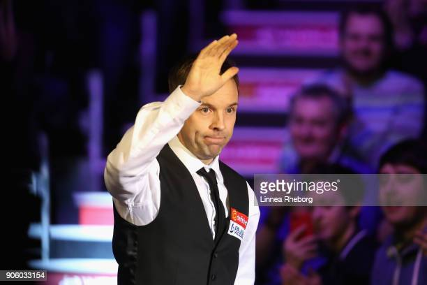 Ali Carter of England greets the audience when making his entrance prior to his first round match against Shaun Murphy of England on day four of The...
