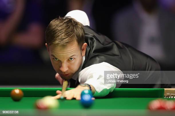 Ali Carter of England in action during his first round match against Shaun Murphy of England on day four of The Dafabet Masters at Alexandra Palace...