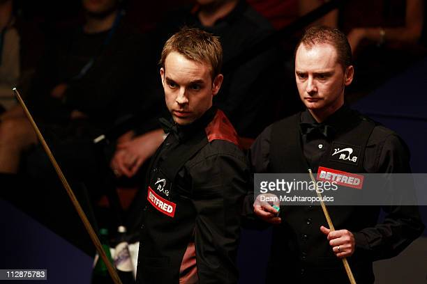 Ali Carter of England looks to play a shot in the round two game against Graeme Dott of Scotland on day seven of the Betfredcom World Snooker...