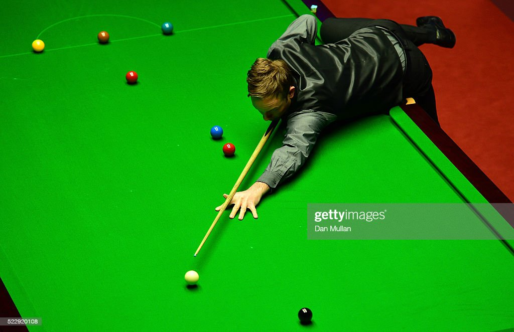 Ali Carter of England plays a shot during his second round match against Alan McManus of Scotland on day six of the World Snooker Championship at The Crucible Theatre on April 21, 2016 in Sheffield, England.