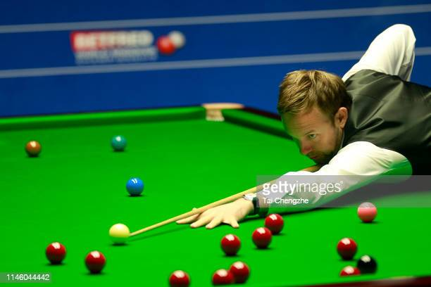 Ali Carter of England plays a shot in the quarterfinal match against Gary Wilson of England on day eleven of the 2019 Betfred World Snooker...
