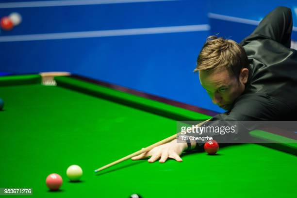 Ali Carter of England plays a shot in the quarterfinal match against Mark Williams of Wales during day eleven of the World Snooker Championship at...