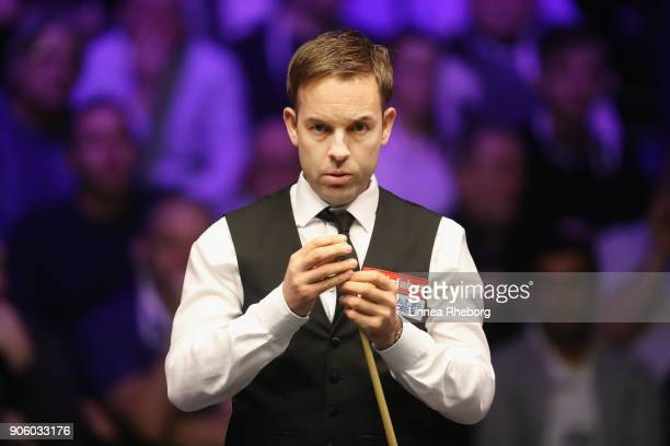 Ali Carter of England prepares to play a shot during his first round match against Shaun Murphy of England on day four of The Dafabet Masters at...
