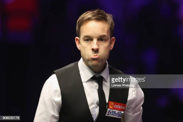 Ali Carter of England reacts during his first round match against Shaun Murphy of England on day four of The Dafabet Masters at Alexandra Palace on...