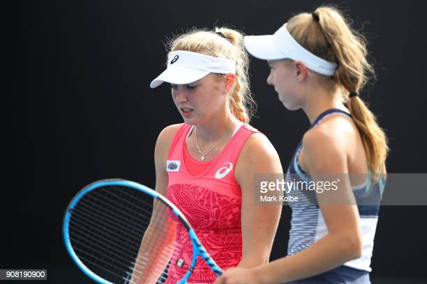 Ali Collins of Great Britain and Stefania Rogozinska Dzik of Poland talk tactics in their doubles match against Gabriella Da Silva Fick of Australia...