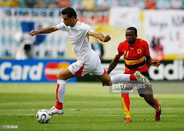Ali Daei of Iran skips past Mateus of Angola during the FIFA World Cup Germany 2006 Group D match between Iran and Angola played at the...