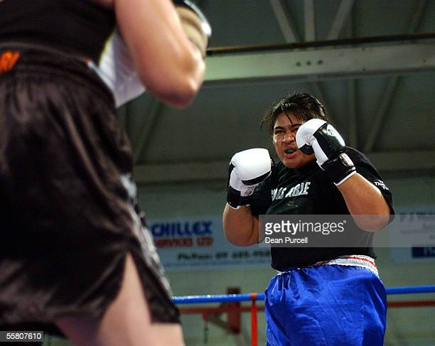 Ali Dutt from New Zealand faces off against LisaMarie Vizaniari from Australia during the South Pacific women's heavyweight boxing title held at the...
