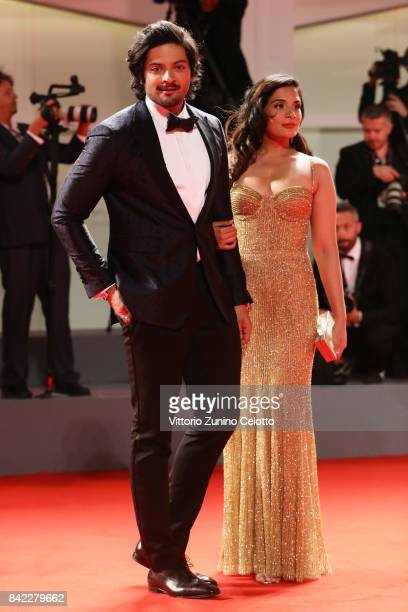 Ali Fazal and a guest walk the red carpet ahead of the 'Victoria Abdul' screening and JaegerLeCoultre Glory To The Filmaker Award 2017 during the...