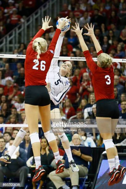Ali Frantti of Penn State University attempt to hit a kill against the University of Nebraska during the Division I Women's Volleyball Semifinals...