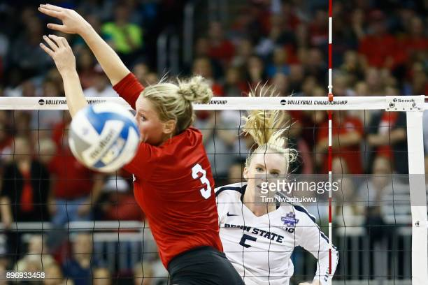 Ali Frantti of Penn State University pikes the ball past Kelly Hunter of the University of Nebraska during the Division I Women's Volleyball...