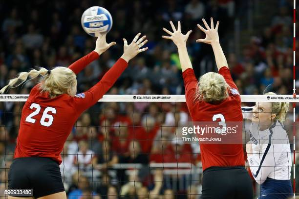 Ali Frantti of Penn State University pikes the ball past Lauren Stivrins and Kelly Hunter of the University of Nebraska during the Division I Women's...