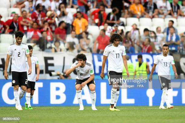Ali Gabr Ahmed Hegazy and Mohamed Elneny of Egypt look dejected following their sides defeat in the 2018 FIFA World Cup Russia group A match between...