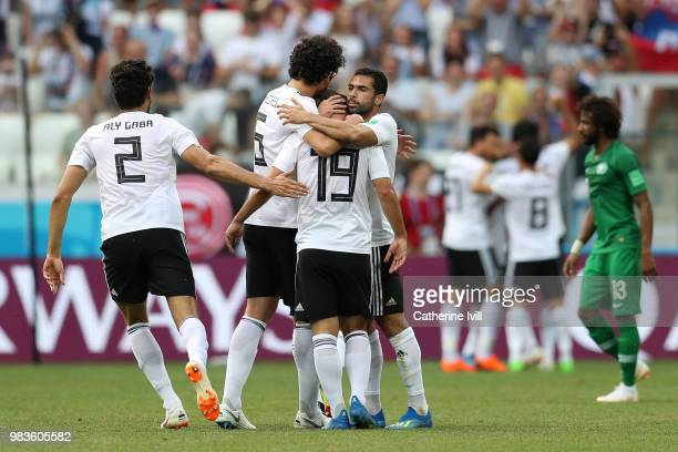 Ali Gabr Ahmed Hegazy Sherif Ekramy and Ahmed Fathi of Egypt celebrate the opening goal during the 2018 FIFA World Cup Russia group A match between...