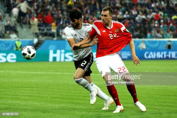 Ali Gabr of Egypt and Artem Dzyuba of Russia compete for the ball during the 2018 FIFA World Cup Russia group A match between Russia and Egypt at...