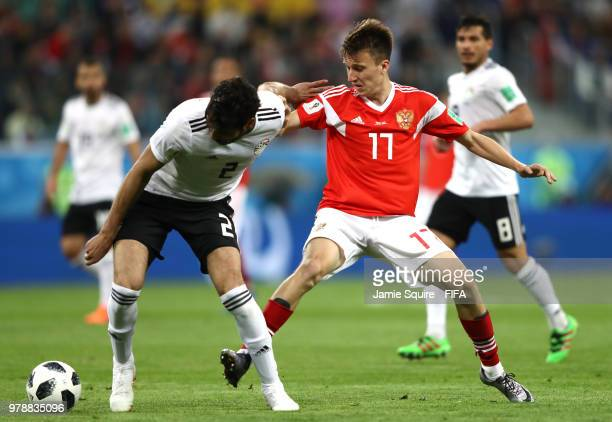 Ali Gabr of Egypt and Roman Zobnin of Russia in action during the 2018 FIFA World Cup Russia group A match between Russia and Egypt at Saint...