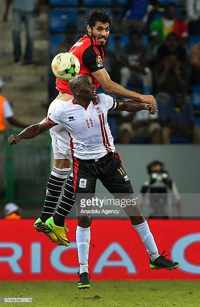 Ali Gabr of Egypt in action against Geofrey Massa of Uganda during the African Cup of Nations 2017 Group D football match between Egypt and Uganda at...