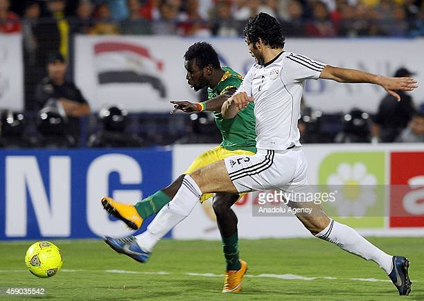 Ali Gabr of Egypt in action against Mame Biram Diouf of Senegal during the Africa Cup of Nations qualification group G match between Egypt and...