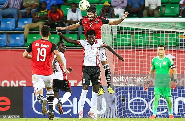Ali Gabr of Egypt in action against Moses Oloya of Uganda during the African Cup of Nations 2017 Group D football match between Egypt and Uganda at...