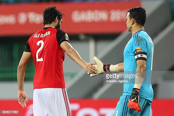 Ali Gabr shakes hands with Essam El Hadary during the African Cup of Nations 2017 quarter final football match between Egypt and Morocco in...