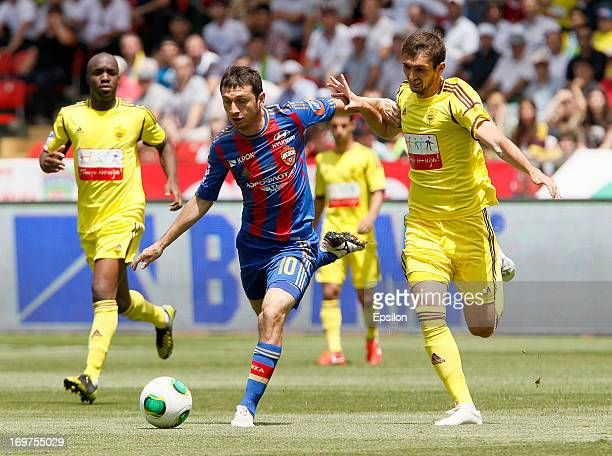 Ali Gadzhibekov of FC Anji Makhachkala is challenged by Alan Dzagoev of PFC CSKA Moscow during the Russian Cup Final match between FC Anji...