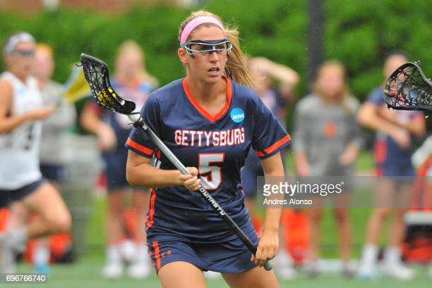 Ali Gorab of Gettysburg College pushes the ball upfield against the College of New Jersey during the Division III Women's Lacrosse Championship held...